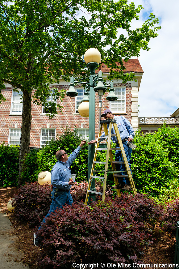 Ole Miss Facilities Management staff upgrade one of the lamppost on campus to LED lights. Photo by Robert Jordan/Ole Miss Communications