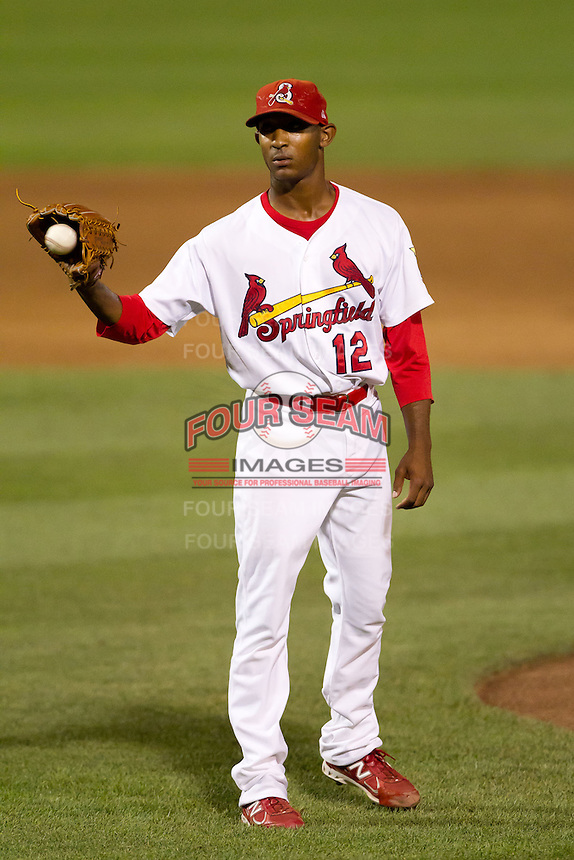 Samuel Freeman (12) of the Springfield Cardinals catches a ball thrown from the umpire during a game against the Tulsa Drillers at Hammons Field on July 19, 2011 in Springfield, Missouri. Tulsa defeated Springfield 17-11. (David Welker / Four Seam Images)