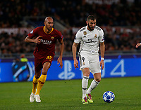 Steven Nzonzi of AS Roma  and Karim Benzema of Real Madrid  during the Champions League Group  soccer match between AS Roma - Real Madrid  at the Stadio Olimpico in Rome Italy 27 November 2018