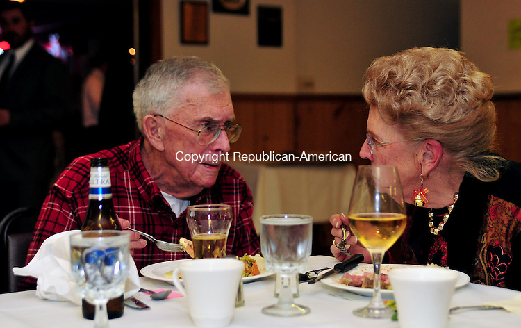 THOMASTON, CT, 03 DEC 11-120311AJ01- Tom Reynonds, a charter member of the Thomaston Fish & Game Club speaks with his wife Mary at a dinner honoring the elder members of the club on Saturday in Thomaston. Alec Johnson / Republican-American