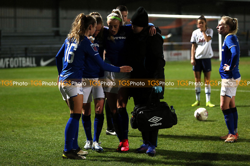 Chloe Kelly of Everton women  leaves the pitch injured after a tackle by Ashleigh Neville of Tottenham Hotspur women  during Tottenham Hotspur Women vs Everton Women, Barclays FA Women's Super League Football at the Hive Stadium on 12th February 2020