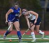 Claire DeSilva #1 of Massapequa, right, moves the ball downfield during the Nassau County varsity field hockey Class A final against Port Washington at Berner Middle School in Massapequa on Sunday, Oct. 28, 2018. (Note to editor: Port Washington #23 (left) not on roster)