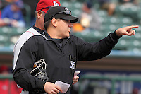Umpire Gerard Ascani goes over the ground rules before a game between the Lehigh Valley Ironpigs and Rochester Red Wings at Frontier Field on April 14, 2011 in Rochester, New York.  Rochester defeated Lehigh Valley with a walk off home run 3-1 in the bottom of the seventh.  (Mike Janes/Four Seam Images)