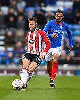 Josh Hancock of Altrincham plays a pass under pressure from Anton Walkes of Portsmouth during Portsmouth vs Altrincham, Emirates FA Cup Football at Fratton Park on 30th November 2019