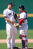 Pitcher Michael Bowden #23 and catcher Mike McKenry #5 of the Pawtucket Red Sox during a game versus the Toledo Mud Hens on May 1, 2011 at McCoy Stadium in Pawtucket, Rhode Island. Photo by Ken Babbitt /Four Seam Images