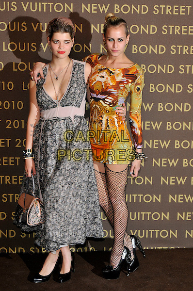 PIXIE GELDOF & ALICE DELLAL .attend the launch of the Louis Vuitton Bond Street Maison in London, England, UK, May 25th, 2010. .full length grey gray print sleeveless dress bag handbag cross necklace fishnet stockings tights black platform shoes orange green patterned body con dress mini long sleeve arm around shoulder tattoo.CAP/PL.©Phil Loftus/Capital Pictures.