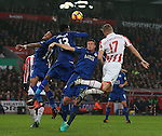 Ryan Shawcross of Stoke City outnumbered 3-1 makes contact with the ball during the English Premier League match at the Bet 365 Stadium, Stoke on Trent. Picture date: December 17th, 2016. Pic Simon Bellis/Sportimage