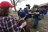 NWA Democrat-Gazette/FLIP PUTTHOFF<br /> BATTLE OF PEA RIDGE REMEMBERED<br /> Rachel Patton (left) of Pea Ridge and her son, Isaac Patton, 7, learn Saturday March 17 2018 about artillery used during The Battle of Pea Ridge during education activities at Pea Ridge National Military Park east of Pea Ridge. Stephen Christian (right) explains the workings of a cannon. The day-long event at the Civil War battlefield observed the 136th anniversary of The Battle of Pea Ridge that raged March 7-8, 1862. The commemoration included cannon firing, Civil War campsites, speakers and a concert by the Northwest Arkansas Heritage Brass Ensemble.