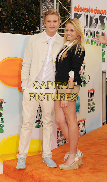 Cody Simpson, Alli Simpson.arriving at the 2012 Nickelodeon Kids' Choice Awards at Galen Center in Los Angeles, California, USA..March 31st, 2012.full length white cream shirt suit beige shorts black jacket brother sister siblings family.CAP/ROT/TM.©Tony Michaels/Roth Stock/Capital Pictures