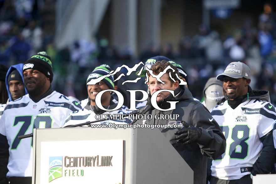 2014-02-05:  Executive Vice President/General Manager John Schneider thanked the fans in attendance during the 12th man parade.  Seattle Seahawks players and 12th man fans celebrated bringing the Lombardi trophy home to Seattle during the Super Bowl Parade at Century Link Field in Seattle, WA.