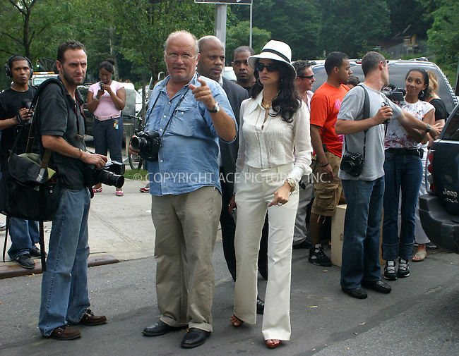 WWW.ACEPIXS.COM ** ** ** June 28 2005....Actress Penelope Cruz was in New York City to shoot an ad campaign for Sean 'Puff Daddy' Combs' clothing line, 'Sean John'. Top fashion photographer Peter Lindbergh did the shoot in several locations around Manhattan. The final location took them to Harlem, where Cruz chatted and photographed locals, and Combs liberally distributed bottles of Krystal Champagne, which retails for around $300 a bottle.....Please byline: PAUL CUNNINGHAM - ACE PICTURES.. *** ***  ..Ace Pictures, Inc:  ..Craig Ashby (212) 243-8787..e-mail: picturedesk@acepixs.com..web: http://www.acepixs.com