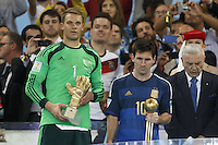 Goalkeeper Manuel Neuer of Germany with the Golden Glove trophy and Lionel Messi of Argentina with the Golden Ball trophy
