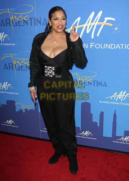 DEBBIE ALLEN.The 7th Annual Alfred E. Mann Foundation for Scientific Research gala held at Sky Bar at Hangar 8 Santa Monica Airport, Santa Monica, CA, USA..October 10th, 2010.full length black trousers jacket top belt low cut neckline cleavage hand finger mouth open.CAP/ADM/KB.©Kevan Brooks/AdMedia/Capital Pictures.