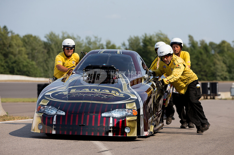 Aug. 18, 2013; Brainerd, MN, USA: NHRA top alcohol funny car driver Frank Manzo is pushed off the track by the safety safari after winning the Lucas Oil Nationals at Brainerd International Raceway. Mandatory Credit: Mark J. Rebilas-