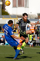 Stuart Sinclair of Bristol Rovers closes down Darius Charles of AFC Wimbledon during the Sky Bet League 1 match between AFC Wimbledon and Bristol Rovers at the Cherry Red Records Stadium, Kingston, England on 17 February 2018. Photo by Carlton Myrie.