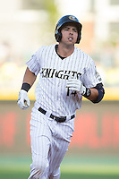 Chris Marrero (14) of the Charlotte Knights rounds the bases after hitting a 2-run home run against the Indianapolis Indians at BB&T BallPark on June 20, 2015 in Charlotte, North Carolina.  The Knights defeated the Indians 6-5 in 12 innings.  (Brian Westerholt/Four Seam Images)