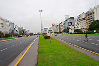the Avenida 9 Julio Avenue of ninth of July, said to be the world's widest street, lined by trees and modern office block buildings. Publicity posters. Buenos Aires Argentina, South America