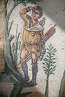 Hunter Roman mosaic floor of the Room of The Small Hunt, no 25 - Roman mosaics at the Villa Romana del Casale ,  circa the first quarter of the 4th century AD. Sicily, Italy. A UNESCO World Heritage Site.