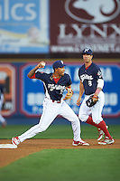 Reading Fightin Phils shortstop J.P. Crawford (2) throws to first as Brodie Greene (8) backs up the play during a game against the New Britain Rock Cats on August 7, 2015 at FirstEnergy Stadium in Reading, Pennsylvania.  Reading defeated New Britain 4-3 in ten innings.  (Mike Janes/Four Seam Images)