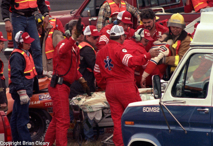 Emergency workers tend to Grant Adcox after his fatal crash Atlanta Journal 500 at Atlanta International Raceway in Hampton , GA on November 19, 1989.  (Photo by Brian Cleary/www.bcpix.com)