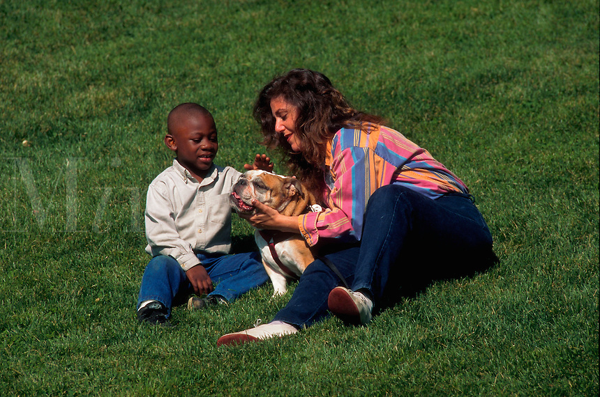 Woman volunteer teached disabled boy how to pet her therapy dog.