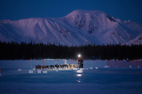 Mats Pettersson  arrives at the Finger Lake checkpoint in the pre-dawn hours on Monday, March 3, during the Iditarod Sled Dog Race 2014.<br />