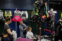 A young girl has her hair done by a vendor at the 2013 World Championships for Irish Dancing in Boston, Massachusetts, USA.  The 2013 competition in Boston is the second time in the competition's 43-year history that the event has been held in the United States.