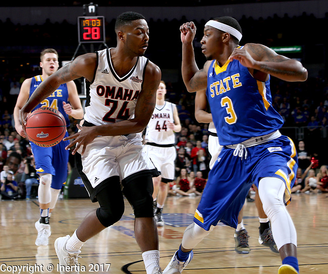 SIOUX FALLS, SD: MARCH 7: Tra-Deon Hollins #24 from Omaha tries to pass the ball behind his back around Chris Howell #3 from South Dakota State University during the Men's Summit League Basketball Championship Game on March 7, 2017 at the Denny Sanford Premier Center in Sioux Falls, SD. (Photo by Dave Eggen/Inertia)