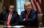 United States President Donald J. Trump reacts during a meeting on youth vaping and the electronic cigarette epidemic in the Cabinet Room at the White House in Washington on November 22, 2019. At left is US Senator Mitt Romney (Republican of Utah).<br /> Credit: Yuri Gripas / Pool via CNP