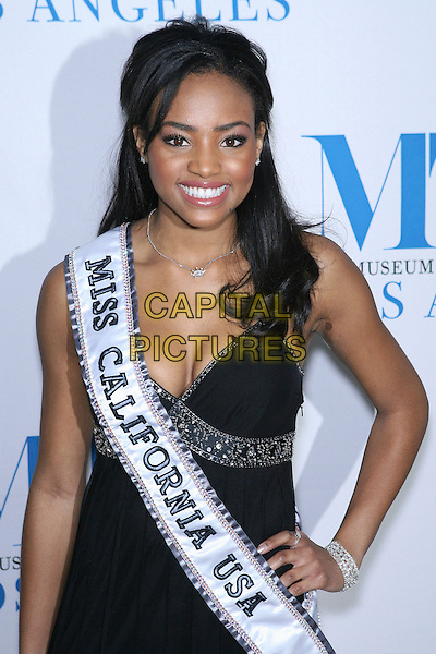MEAGAN TANDY (Miss California 2007).Launch party for the second year of MTR?s She Made It: Women Creating Television and Radio - Arrivals held at the Museum of Television & Radio, Beverly Hills, California, USA..December 5th, 2006.half length dress sash hand on hip black .CAP/ADM/ZL.©Zach Lipp/AdMedia/Capital Pictures