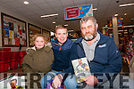 Tomas Ó Sé signing his book The White Heat to Emma and Tom Ó Cinnéide (Ventry) at Garvey's Supervalu, Dingle, on Saturday afternoon.