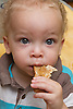 Toddler eating toast. (This photo has extra clearance covering Homelessness, Mental Health Issues, Bullying, Education and Exclusion, as well as the usual clearance for Fostering & Adoption and general Social Services contexts,)