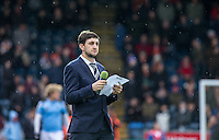 Wycombe Head of Media Matt Cecil reads out the teams as the rain falls during the Sky Bet League 2 match between Wycombe Wanderers and Luton Town at Adams Park, High Wycombe, England on 6 February 2016. Photo by Andy Rowland.