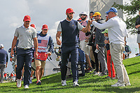 Brooks Koepka (USA) and Dustin Johnson (USA) shake hands with fans on their way to the 4th tee during round 3 Four-Ball of the 2017 President's Cup, Liberty National Golf Club, Jersey City, New Jersey, USA. 9/30/2017.<br /> Picture: Golffile | Ken Murray<br /> <br /> All photo usage must carry mandatory copyright credit (&copy; Golffile | Ken Murray)