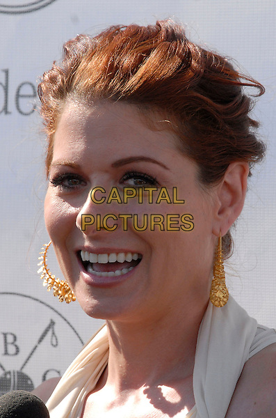 DEBRA MESSING.Debra Messing hosts Opening Day of the 2007 Mercedes-Benz Polo Challenge at the Bridgehampton Polo Club, Bridgehampton, New York, USA,.21 July 2007..portrait headshot gold earrings.CAP/ADM/BL.©Bill Lyons/AdMedia/Capital Pictures. *** Local Caption ***