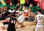 RAPID CITY, S.D.-- MARCH 21, 2015:  Brayden McNeary #23 of Aberdeen Roncalli gets fouled by Riley Schmidt #22 of Dell Rapids in the final minute of their championship game at the 2015 South Dakota  State A Boys Basketball Tournament at the Don Barnett Arena in Rapid City Saturday. (Photo by Dick Carlson/Inertia)