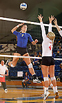 BROOKINGS, SD - OCTOBER 5:  Tiara Gibson #7 from South Dakota State University winds up for a kill attempt past Audrey Reeg #4 from the University of South Dakota in the first game of their match Saturday night at Frost Arena. (Photo by Dave Eggen/Inertia)