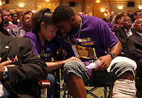 Marcus Martin, right, hugs his fiancé Marissa Blair, left, during a memorial for Heather Heyer Wed., August 16, 2017, at the Paramount Theater in Charlottesville, Va. Martin pushed his fiancé out of the way of the vehicle that killed Heyer the previous weekend after the Unite The Right rally.  Photo/Andrew Shurtleff
