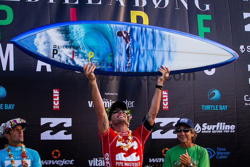 HONOLULU - (Friday, December 14, 2012) Josh Kerr (AUS), Joel Parkinson (AUS) and Gerry Lopez (HAW). -- The BILLABONG PIPE MASTERS In Memory of Andy Irons  concluded today in spectacular way. The 2012 ASP World Title was decided between Joel Parkinson (AUS) and Kelly Slater (USA) with Parkinson finally holding the World Title trophy above his head in front of thousands of surf fans..Slater was defeated by Josh Kerr (AUS) in the semi finals finishing his chance of winning a 12th World Title. Waves were  in the 6 to 8-feet for most of the day..Sebastien Zietz (HAW) won the 2012 Vans Triple Crown of Surfing title winning $100,000, a Harley Davidson motorcycle and a $10,000 Nixon watch..Photo: joliphotos.com