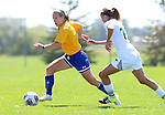 BROOKINGS, SD - AUGUST  22: Shelby Raper #4 from South Dakota State University pushes the ball past Lauryn Delzer #15 from Green Bay in the first half of their game Sunday afternoon at Fischback Soccer Field in Brookings. (Photo by Dave Eggen/Inertia)