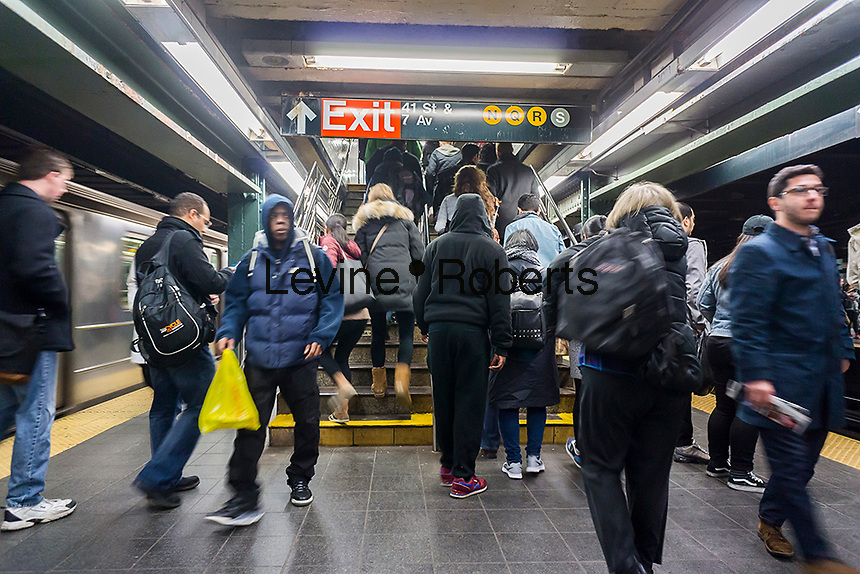 Travelers exit the Times Square subway station in New York on Saturday, March 19, 2016.  (© Richard B. Levine)