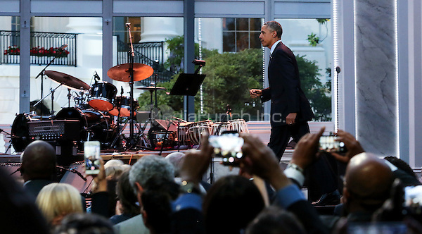 United States President Barack Obama arrives to deliver remarks at the International Jazz Day Concert on the South Lawn of the White House, in Washington, DC, April 29, 2016. The event includes a performance by Aretha Franklin and is presented by Morgan Freeman. <br /> Credit: Aude Guerrucci / Pool via CNP/MediaPunch