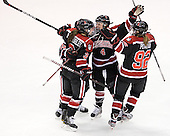 Katie MacSorley (Northeastern - 3), Colleen Murphy (Northeastern - 10), Maggie DiMasi (Northeastern - 4) and Lucie Povova (Northeastern - 92) celebrate DiMasi's goal. - The Boston University Terriers defeated the visiting Northeastern University Huskies 3-2 on Saturday, January 28, 2012, at Agganis Arena in Boston, Massachusetts.