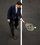 BANGKOK, THAILAND - SEPTEMBER 30:  Thailand's Prime Minister Abhisit Vejjajiva plays a ball the opening ceremony of the PTT Thailand Open at Impact Arena on September 30, 2010 in Bangkok, Thailand. Photo by Victor Fraile / The Power of Sport Images