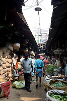 People walk through the Kolay market in central Kolkata.<br />
