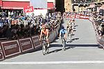 Riders cross the finish line at the end of a very dusty Strade Bianche 2019 running 184km from Siena to Siena, held over the white gravel roads of Tuscany, Italy. 9th March 2019.<br /> Picture: Eoin Clarke | Cyclefile<br /> <br /> <br /> All photos usage must carry mandatory copyright credit (&copy; Cyclefile | Eoin Clarke)