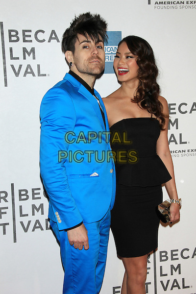 "Davey Havok & Jamie Chung .The 2012 Tribeca Film Festival World Premiere of ""Knife Fight"" at the Tribeca Performing Arts Center, New York, NY, USA..April 25th, 2012 .half length black strapless dress clutch bag peplum gold blue suit stubble facial hair mouth open smiling laughing .CAP/LNC/TOM.©TOM/LNC/Capital Pictures."
