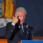 Elmont, New York, USA. April 5, 2016. Former President Bill Clinton, touching his index finger to his forehead while giving a speech, is the headline speaker as he campaigns at an Organizing Event rally in Elmont, Long Island, on behalf of his wife, Hillary Clinton, the leading Democratic presidential candidate, and former Secretary of State and U.S. Senator for New York. Podium has 'Fighting for us' slogan on sign. The New York Democratic Primary takes place April 19th.