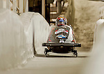 8 January 2016: Yunjong Won, piloting his 2-man bobsled for South Korea, enters the Chicane straightaway on his first run, ending the day with a combined 2-run time of 1:51.12 and earning a 3rd place finish at the BMW IBSF World Cup Championships at the Olympic Sports Track in Lake Placid, New York, USA. Mandatory Credit: Ed Wolfstein Photo *** RAW (NEF) Image File Available ***