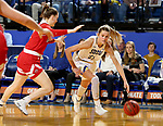 BROOKINGS, SD - FEBRUARY 22: Tylee Irwin #21 of the South Dakota State Jackrabbits drives to the basket against  the South Dakota Coyotes Saturday at Frost Arena in Brookings, SD. (Photo by Dave Eggen/Inertia)